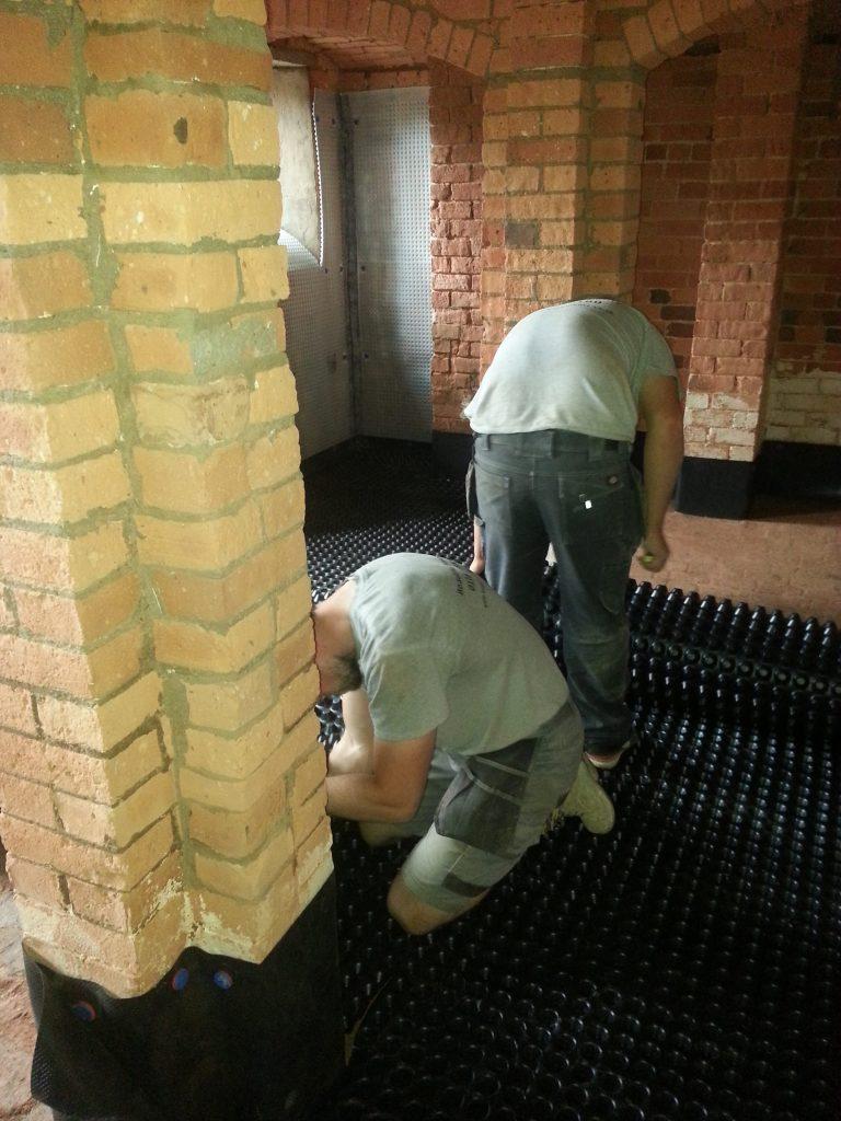 Crew installing membranes
