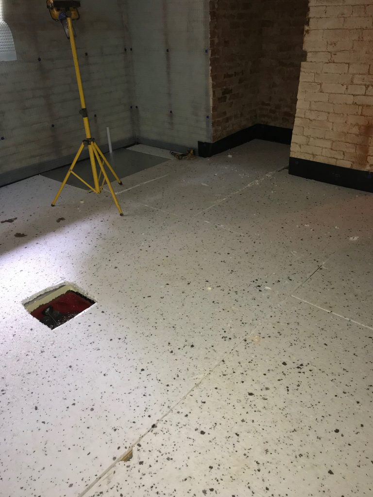 Insulation laid with hope cut out for sump access
