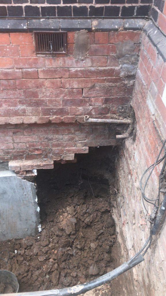 Creation of opening for new external door to basement