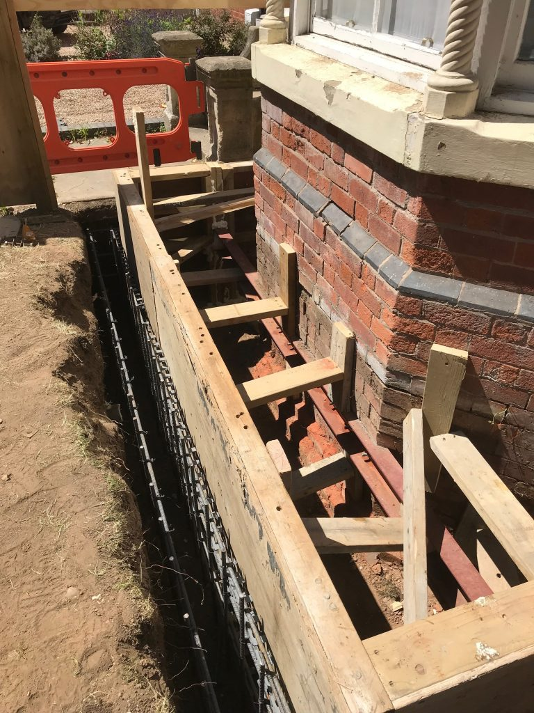 Retaining wall for new light well ready for concrete