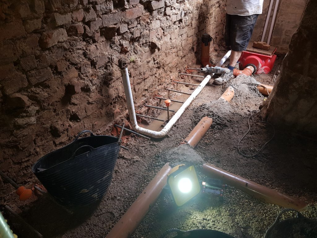 Underground drainage leading to a sump for the waterproofing system