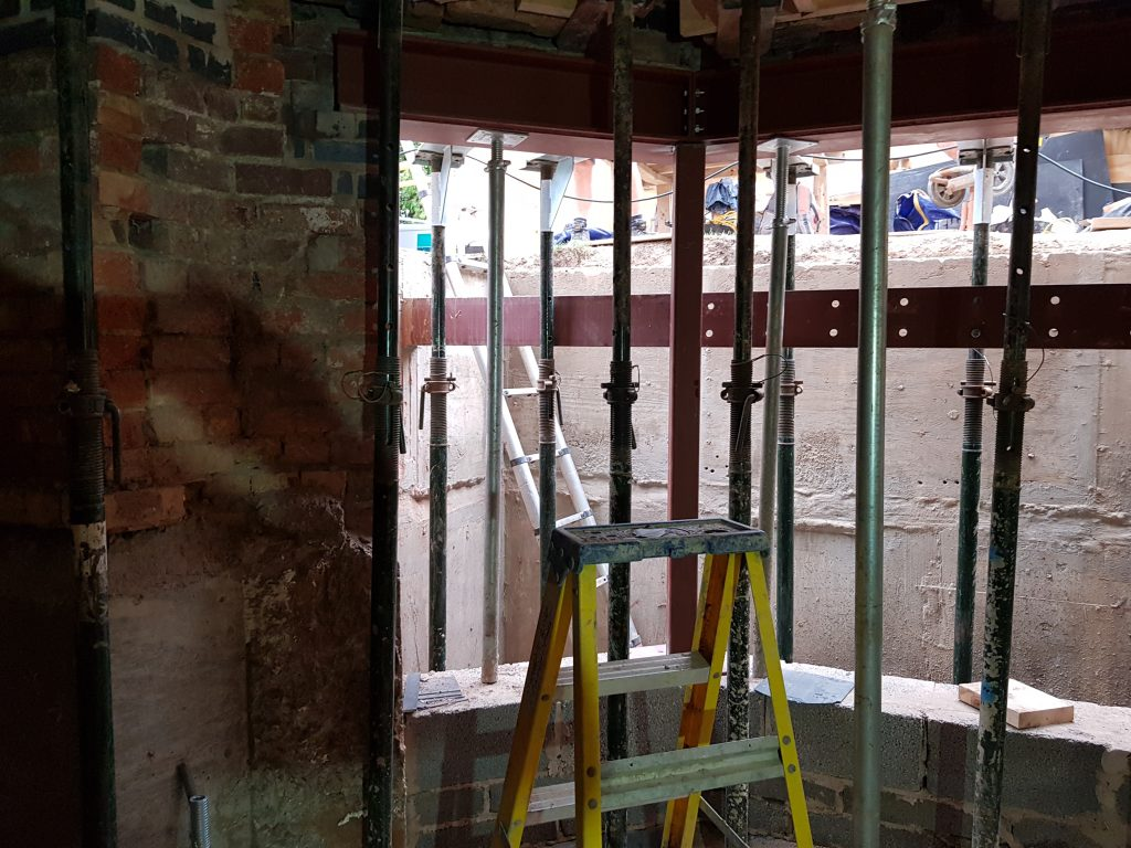 Steel beams and new blockwork creating a new window and escape route to the light well