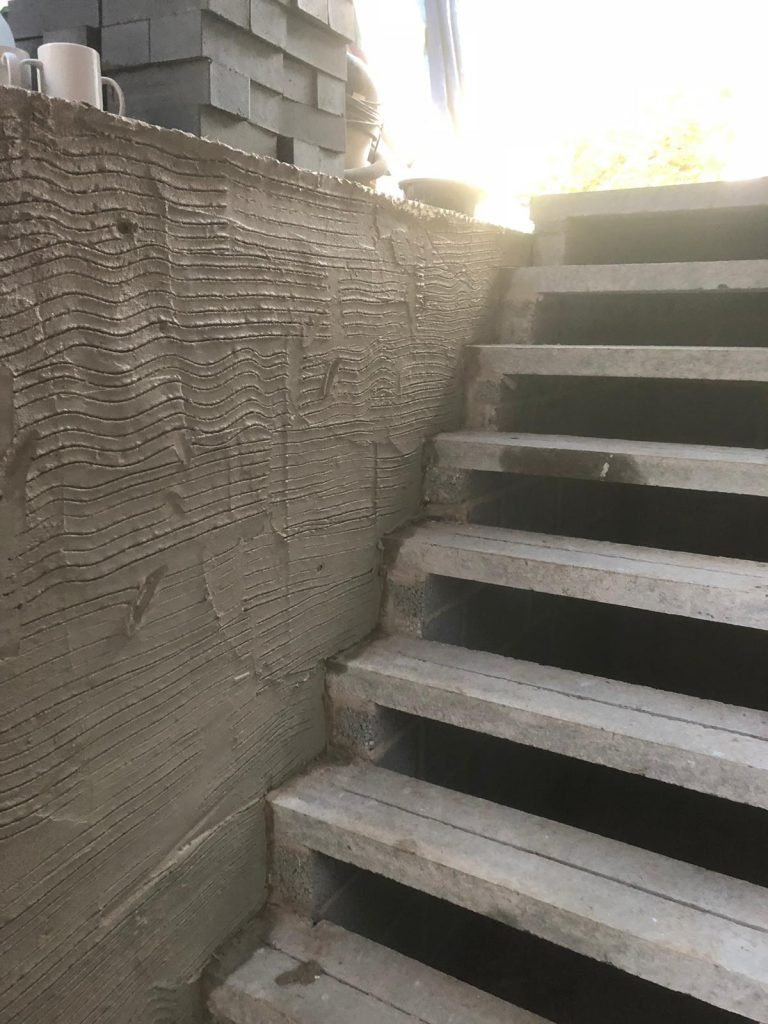 New external staircase with render being applied for a finish