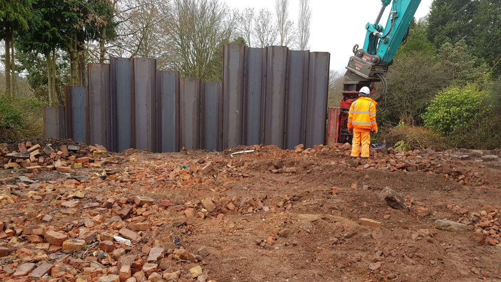 Sheet piles linked together to hold back land, neighbouring property and the excavation