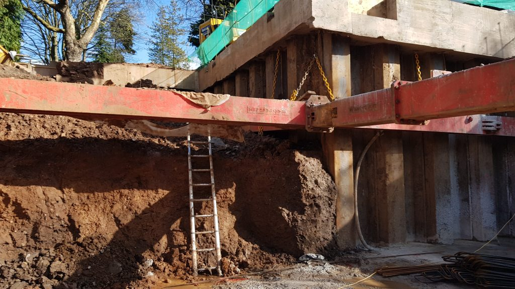Large supports installed to allow second layer of excavation to formation depth