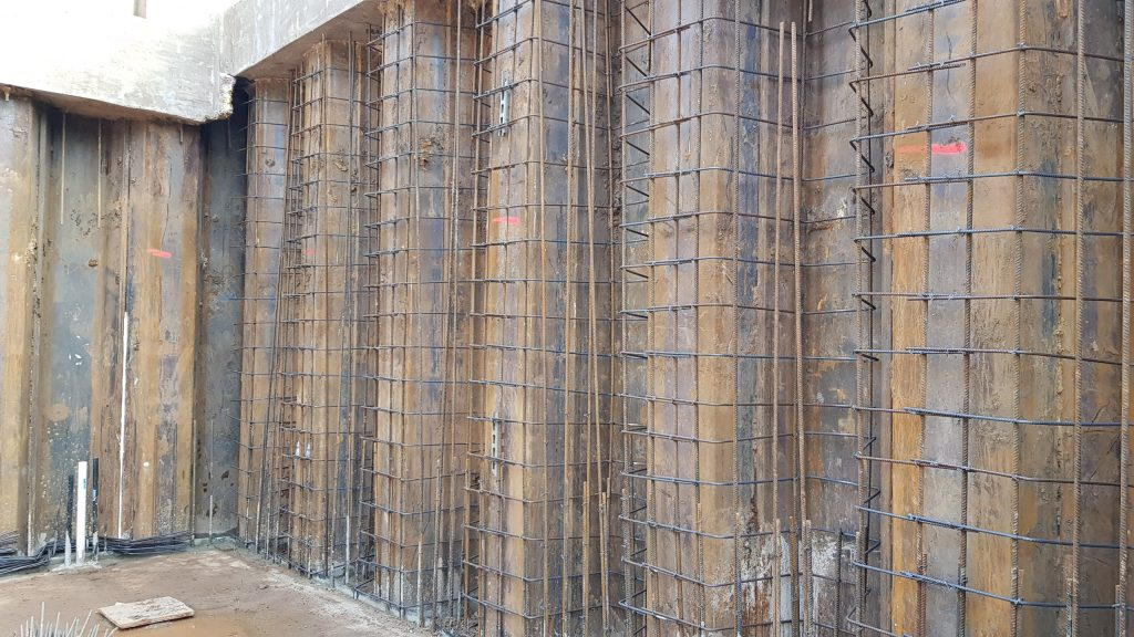Reinforcing for the walls following the sheet piling