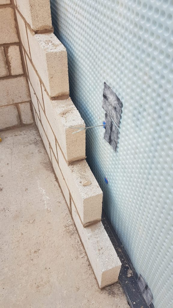 Internal block work in front of waterproofing and perimeter channels