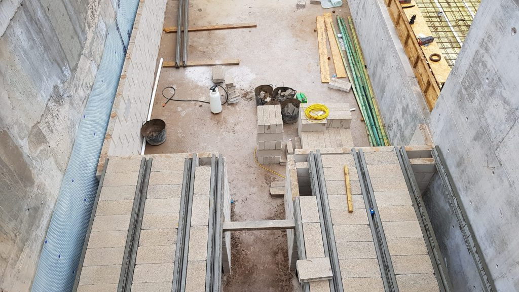 "Block and beams creating ""lower ground floor"""