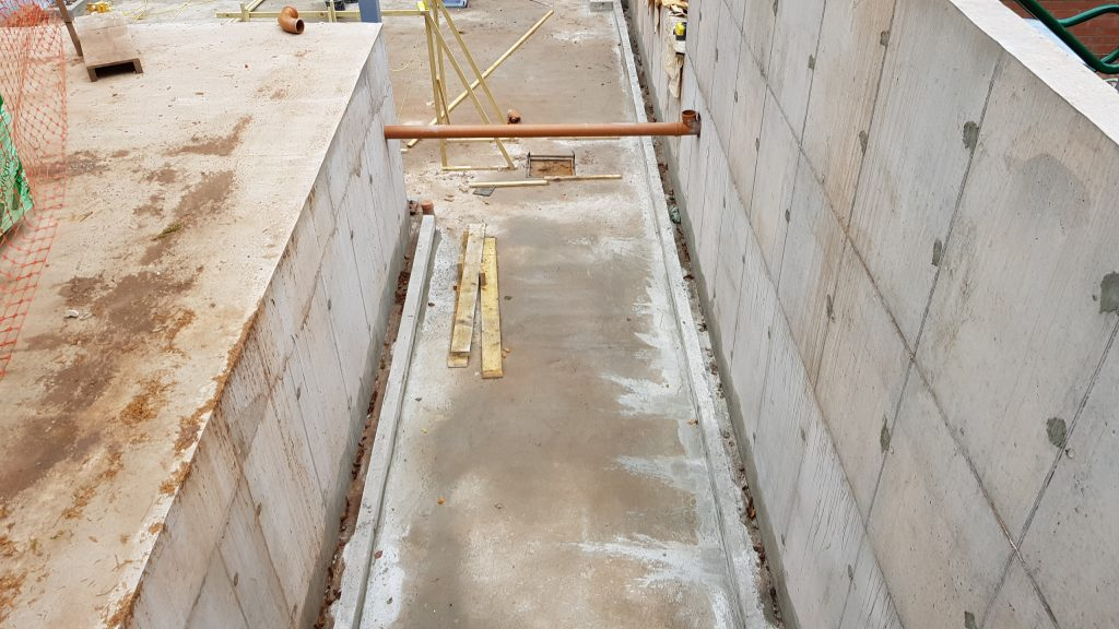 Newly formed channels on floor to take water to sumps