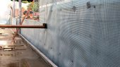 External wall membrane with seals around drainage pipe