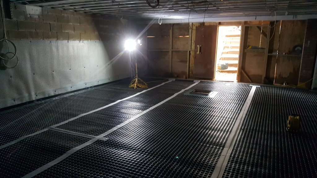 Wall and floor membrane linked with perimeter drainage channel