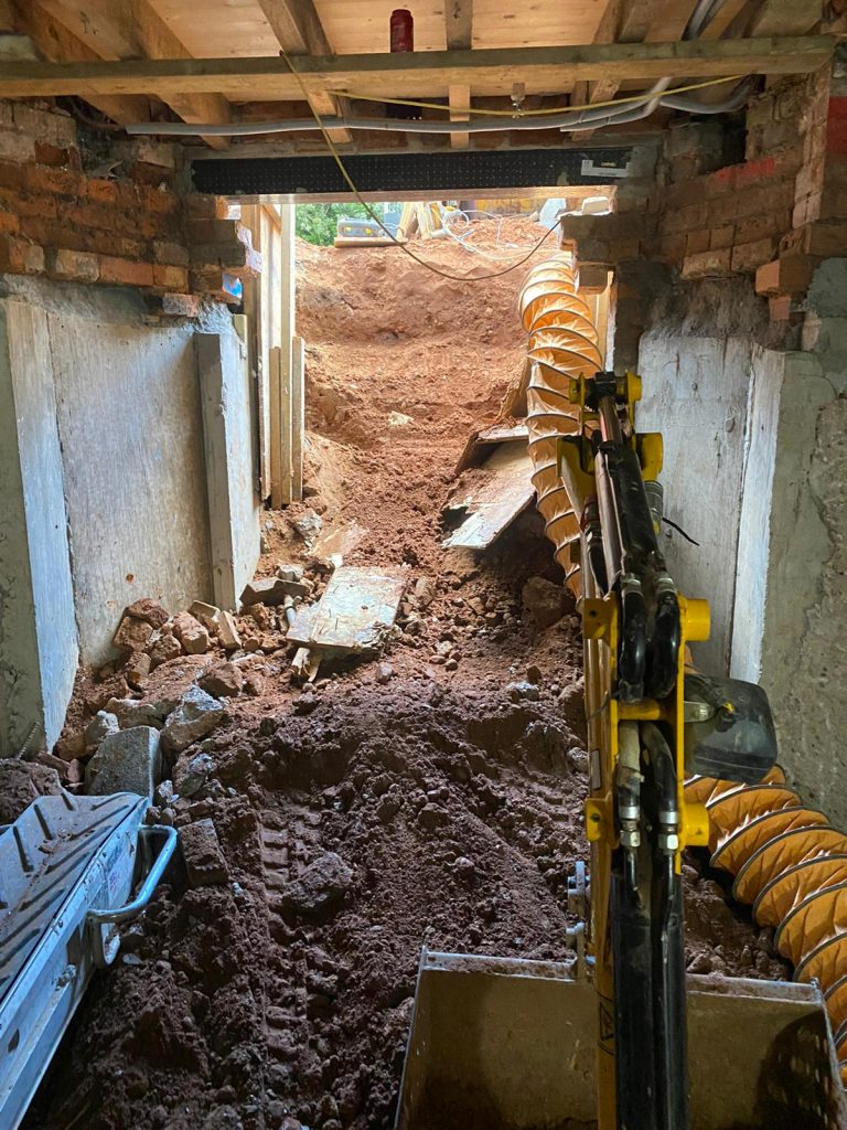Excavating a new light well to the front garden
