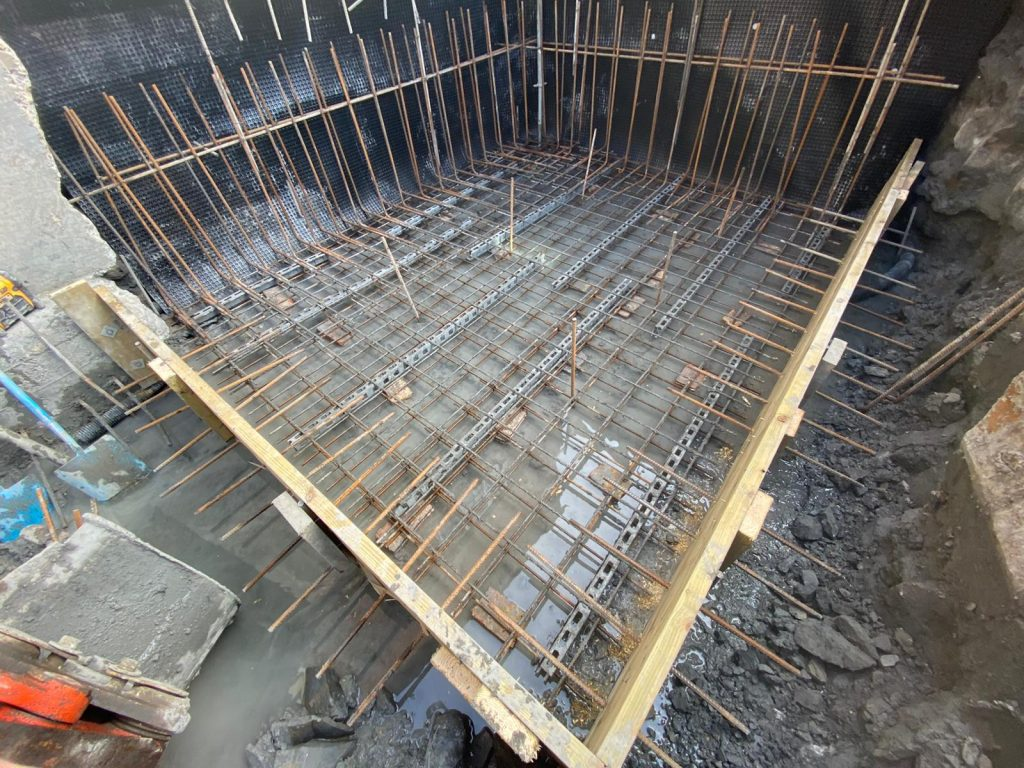 Ring beam base cast in sections and linked to all others
