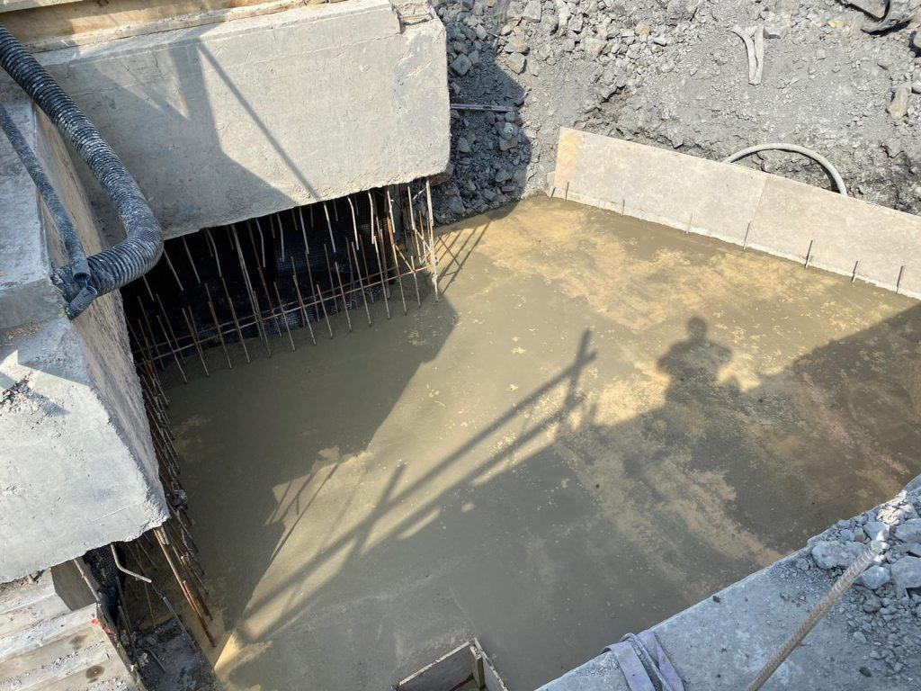 Base cast in concrete
