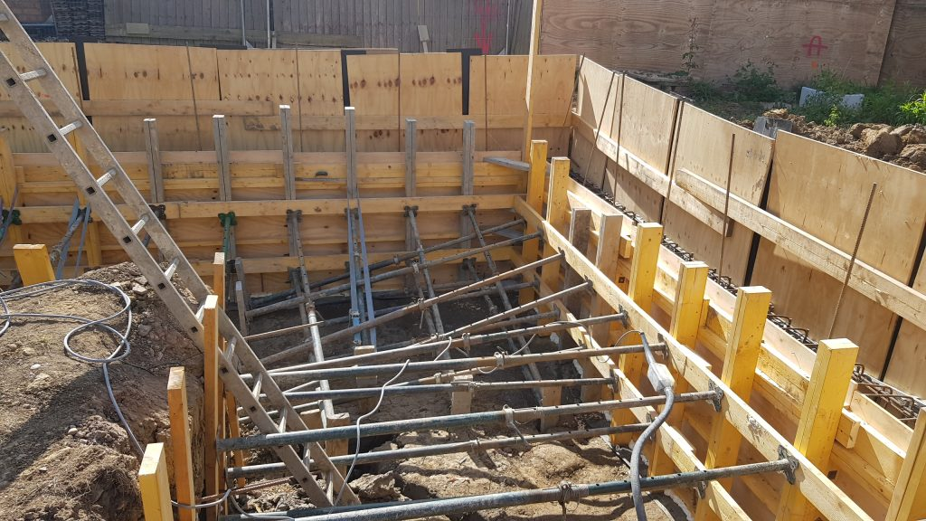 Shuttering for the ring beam is propped for concrete