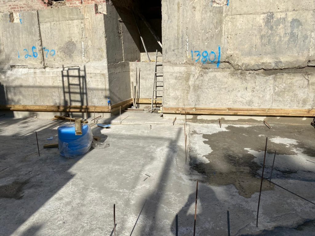 Ring beam underpinned to form basement walls