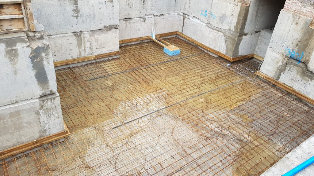 Perimeter drainage channel created all around basement walls