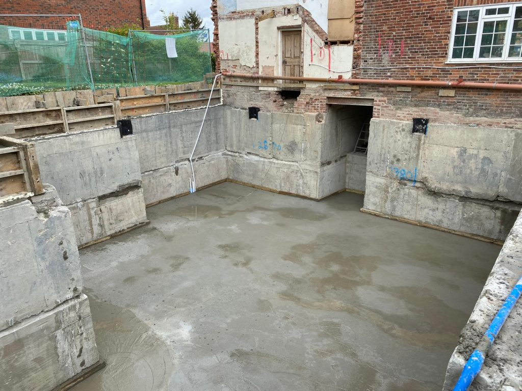 Stage 1 complete. House supported & basement walls and slab finished