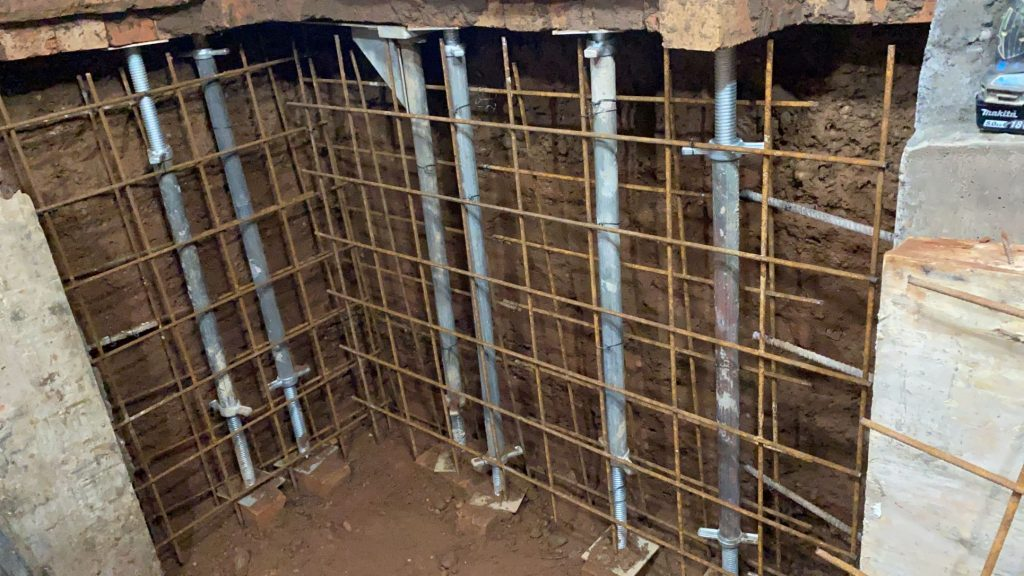 All underpin sections reinforced with steel