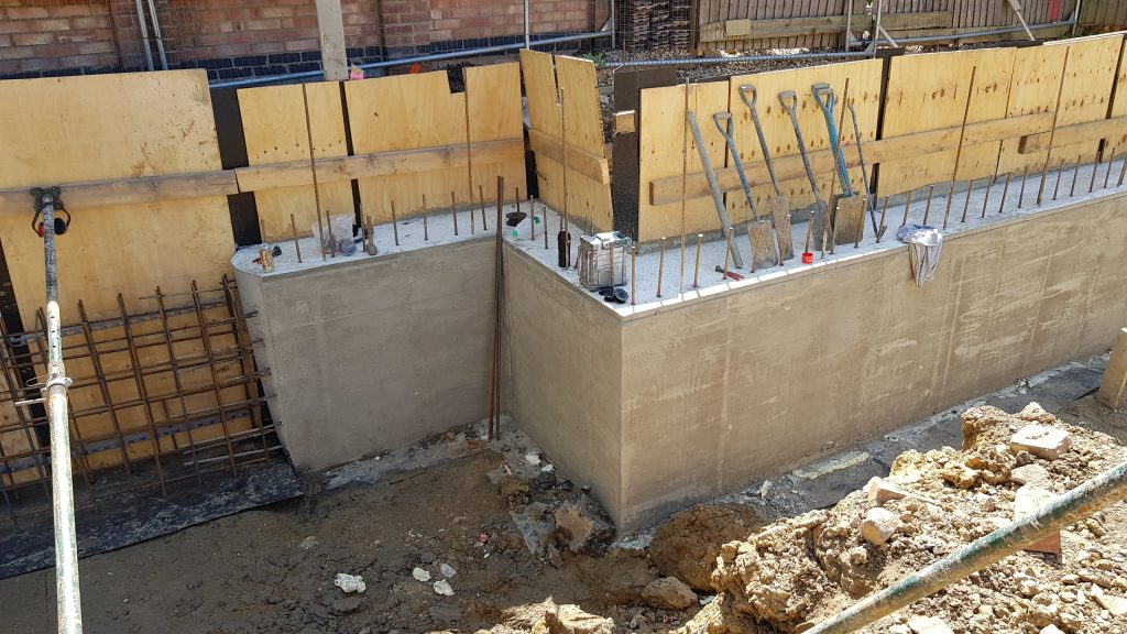 Ring beam is cast and shuttering stripped, stabilising the neighbouring property