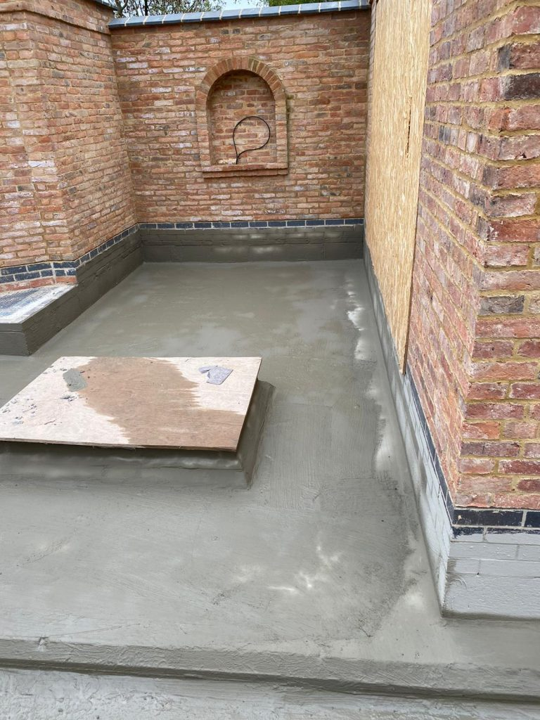 Second layer of barrier waterproofing system applied