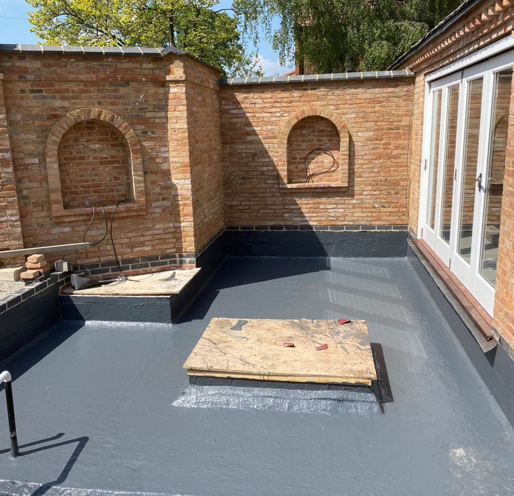Final layer of barrier waterproofing system applied